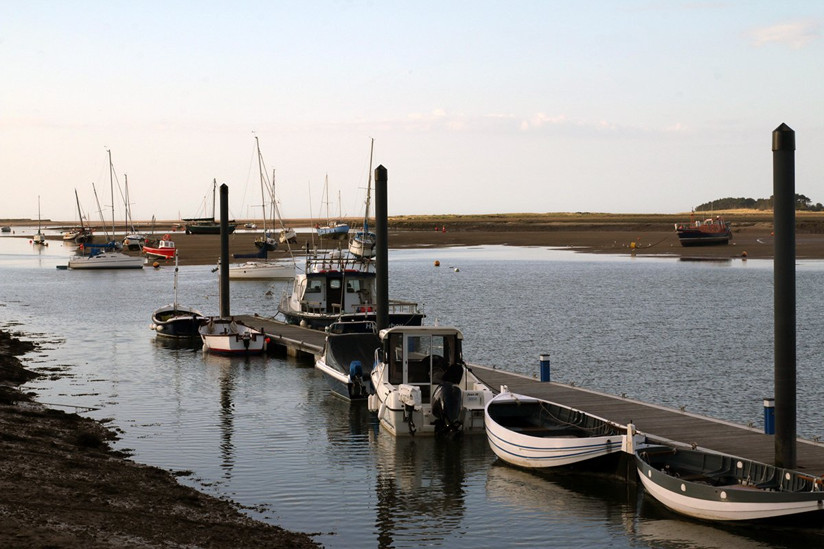 Boats in the harbour at Wells-Next-The-Sea, UK. Norfolk Coast Path National Trail. Copyright Stephanie Boon, 2018. All Rights Reserved.