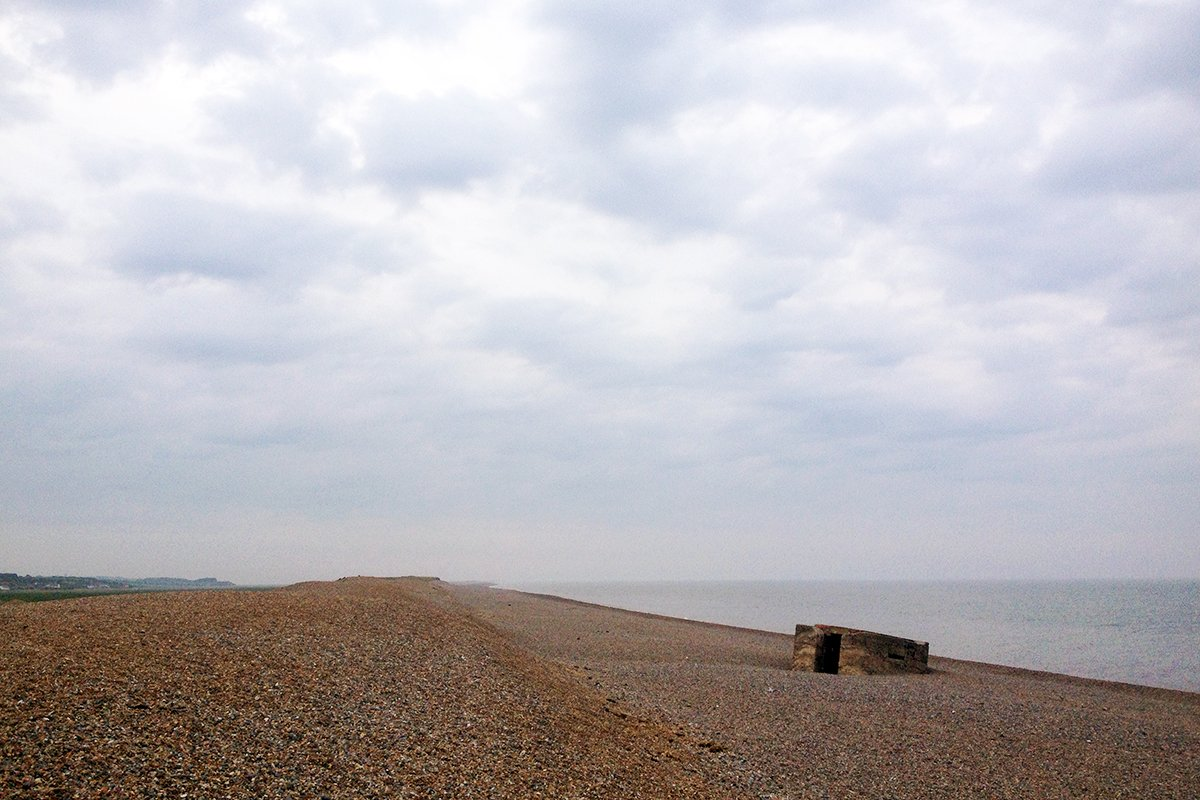 Shingle beach and WWII bunker. Norfolk Coast Path National Trail. Copyright Stephanie Boon, 2018. All Rights Reserved.