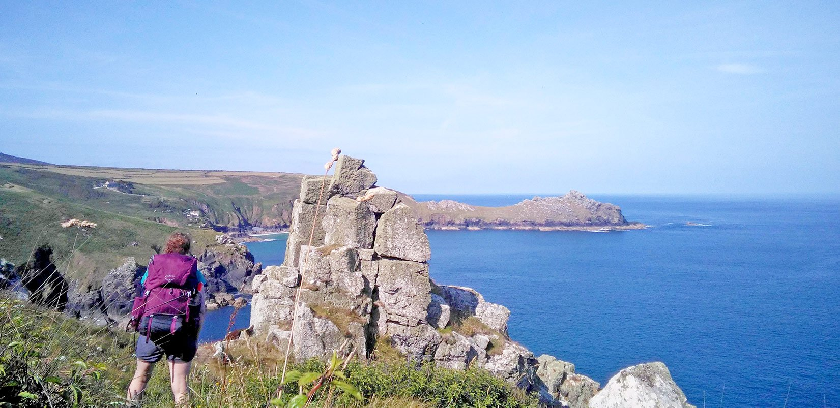 Backpacking on the South West Coast Path in Cornwall at a rocky Gurnards Head